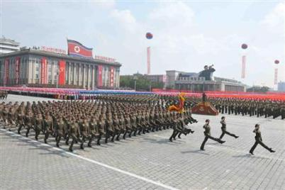 A view is seen of a parade of the Worker-Peasant Red Guards and a mass rally in Pyongyang